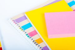 Colorful notebooks on wooden background. Colorful notebooks on a  white wooden background Royalty Free Stock Photography