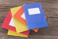 Colorful notebooks on wooden background Royalty Free Stock Photography