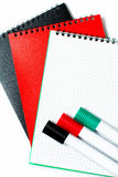 Colorful notepads and markers Royalty Free Stock Images