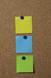 Colorful notes on board. A set of three colorful notes on a bulletin board Stock Photography