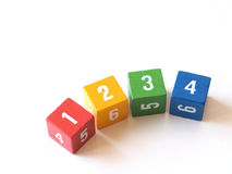 Colorful numbered blocks for learning (I). Rainbow of numbered wooden blocks suitable for use in the classroom or for games Royalty Free Stock Photo