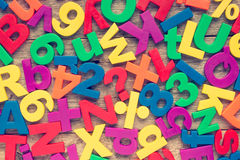 Colorful numbers and alphabet letters. Set of plastic colorful numbers and alphabet letters Royalty Free Stock Photos