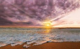 Colorful ocean beach sunrise Stock Images