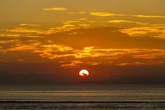 Colorful ocean beach sunrise. Colorful ocean beach sunrise in Bali island, Indonesia Stock Image