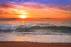 Colorful ocean beach sunrise. Colorful ocean beach sunrise with deep blue sky Stock Photo