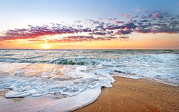 Colorful ocean beach sunrise. Colorful ocean beach sunrise with deep blue sky and sun rays Stock Image