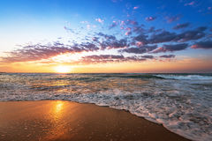 Colorful ocean beach sunrise. Royalty Free Stock Images