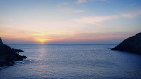 Coastal Landscape At Sunset. Colorful ocean landscape with setting sun and calm sea stock video