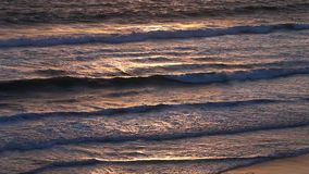 Colorful ocean water surface during sunset stock video