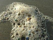 Colorful Ocean Wave Foam Bubbles on Beach Sand. Colorful Ocean Wave Foam Bubbles on Beach Sand on Daytona Beach at Daytona Beach Shores, Florida Royalty Free Stock Photos