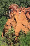 Colorful ochre rocks in the woods near Roussillon Royalty Free Stock Photo