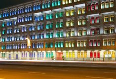 Colorful Office Building In The Night. Old office building with many colorful windows seen during the night stock photo