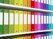 Colorful office folders on the shelves Royalty Free Stock Photo