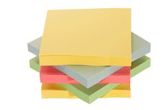 Colorful office paper. Stacks of colorful office adhesive paper Royalty Free Stock Photography