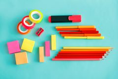 Colorful office stationary on pastel background. Top view portrait of colorful office stationary on pastel background Royalty Free Stock Image