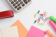 Colorful Office Supplies with Calculator and Red Stapler Royalty Free Stock Photography