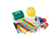Colorful office supplies and green  apple Royalty Free Stock Photos