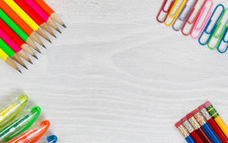 Colorful Office Supplies on White Desktop Royalty Free Stock Image
