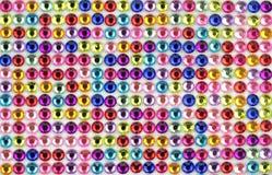 Colorful og shiny gems background. Royalty Free Stock Photos
