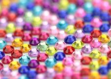 Colorful og shiny gems background. Royalty Free Stock Images