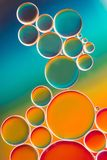 Colorful oil bubbles in water. Colorful abstract of oil bubbles in water Royalty Free Stock Photos