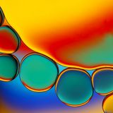 Colorful oil droplets. Abstract image of oil droplets with colorful background stock photos