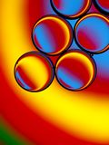Colorful oil droplets in water Stock Image
