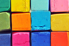 Colorful oil pastels. Lined up in the box macro shot Stock Photo