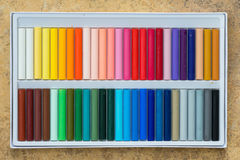 Colorful oil pastels in a box Stock Photos