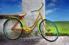 Colorful old bike. Old bike leaned against the wall Stock Photography