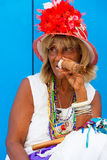 Colorful old black lady with a fine cuban cigar Royalty Free Stock Photography