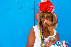 Colorful old black lady with a fine cuban cigar Stock Photography