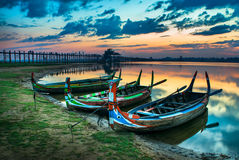 Colorful old boats on a lake Stock Photos
