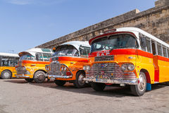 Colorful old British buses, Valletta, Malta. Royalty Free Stock Photos
