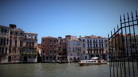 Colorful Of Old Building And River. Old building on riverbank with different styles windows and water way transport in Venice Italy royalty free stock images