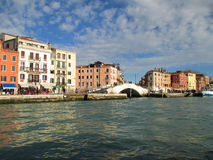 Colorful old buildings and the white stone bridge seen from the Grand Canal of Venice Royalty Free Stock Photos