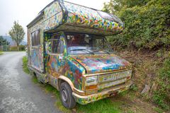 Colorful old camper parked outdoors stock image