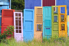 Colorful Old Doors Collection. Collection of colorful old wooden doors leaning on fence Royalty Free Stock Photography