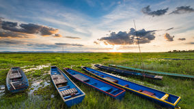 Colorful old fisher boats at the lake with sunset Stock Photo