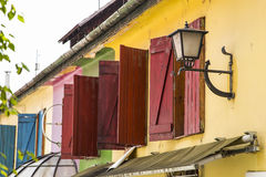 Colorful old house. With shutters in a lane Royalty Free Stock Photos