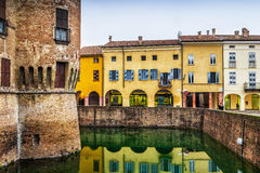 Colorful old houses along the fosse of the castle in Fontanellat Royalty Free Stock Photography