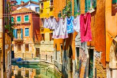 Colorful old houses by canal in Venice Stock Photos