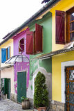 Colorful old houses. Colorful, shabby old houses in a romantic lane Stock Images
