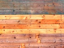 Colorful old rustic wooden plank wall or floor with some of the boards stained blue made of reused timber. Colorful old rustic wooden plank wall or floor with royalty free stock photo