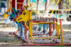 Colorful old  and rusty iron rocking horse Stock Photos