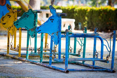 Colorful old  and rusty iron rocking horse Royalty Free Stock Photography