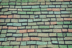 Colorful Old Shingled Roof. Green and brown old-fashioned shingled roofing Royalty Free Stock Photography
