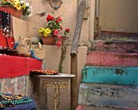 Colorful Old Steps & Baskets with Beads. These colorful old steps and handrail are a sort of false entrance way/courtyard to a funky bead shop tucked away in a royalty free stock photos
