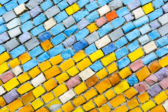 Colorful old stone mosaic on the wall, yellow tiles. Royalty Free Stock Photos