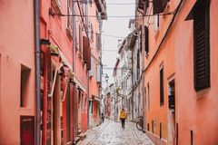 Colorful Old Town street perspective view in Rovinj, Istria, Croatia. Trend photography on the theme of the color of the year Panton 2019 - Living Coral royalty free stock photos